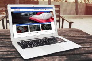 Geni CarCare website laptop